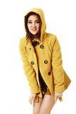 Attractive woman in yellow coat Stock Image