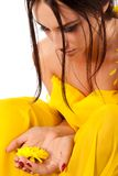 Attractive woman with yellow flower in hands Royalty Free Stock Image
