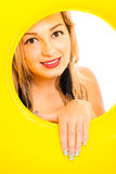 Attractive woman with yellow rubber ring Stock Photos