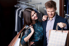 Attractive woman and young man are in the shop Stock Photo