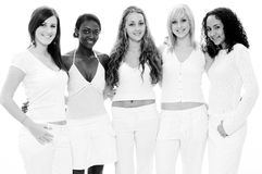 Attractive Women. A monochrome photo of five pretty young women in white on white Royalty Free Stock Image