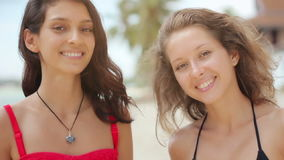 Attractive women at the beach smiling in front of camera stock video footage