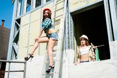 Attractive women on construction site Stock Photography