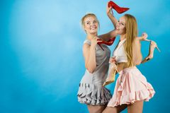 Women presenting high heels shoes Royalty Free Stock Image