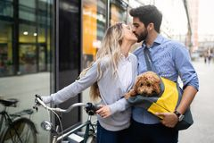 Happy young couple spending time together with dog and bicycles. Attractive women and handsome men spending time together with dog and bicycles royalty free stock photography