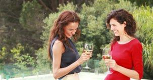 Attractive women having a drink outdoor stock video footage