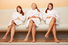 Attractive women on heat bench. The attractive smiling women sitting on a heat bench stock photos