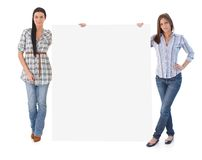 Attractive women holding blank sheet Stock Image