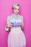 Attractive women holding purple gift box with ribbon Stock Images