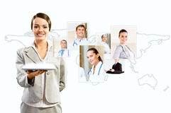Attractive woman holding a tablet pc and smiling. Attractive women holding a tablet pc and smiling, concept of social networks, collage Royalty Free Stock Photo