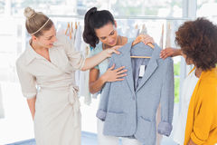 Attractive women looking at blazer Stock Photo