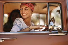 Attractive woman looking outside the car window Stock Images