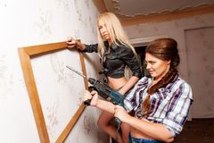 Attractive women with puncher and frame Stock Photos