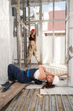 Attractive women relax on construction site Royalty Free Stock Photo