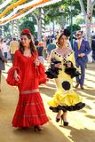 Attractive Women taking a walk and dressed in traditional costumes at the Seville`s April Fair. Seville, Spain - May 03, 2017: Attractive Women taking a walk royalty free stock photography