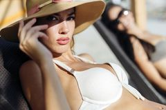 Attractive woman tanning on beach Royalty Free Stock Image
