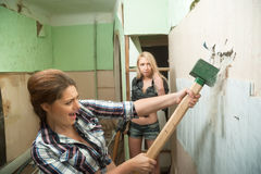 Attractive women with tools work indoor Royalty Free Stock Photography