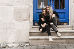 Outdoor portrait of happy lovely young teens traveling in old european city, Lviv, Ukraine stock photos