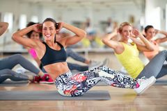 Attractive women train in group. On fitness class royalty free stock photos