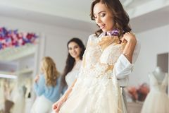Attractive women with wedding dresses stock image