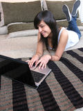 Attractive women working on her laptop Stock Photography