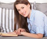 Attractive womna reading a book Stock Photos