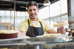 Attractive worker in apron posing Stock Photo