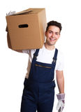 Attractive worker with a box on his shoulder Royalty Free Stock Photos