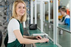 Attractive worker in the factory Stock Photography