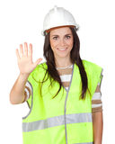 Attractive worker with reflector vest saying Stop Royalty Free Stock Photos