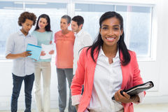 Free Attractive Worker With Planner Smiles At Camera With Colleagues In Background Royalty Free Stock Image - 40687746