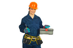 Attractive worker woman with tools Royalty Free Stock Image