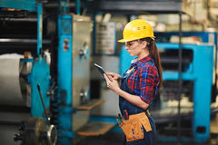 Attractive Worker Working on Digital Tablet stock photo