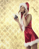 Attractive xmas woman with bauble Royalty Free Stock Photo