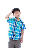 Attractive 7 year old boy making thinking expression. Isolated o Stock Image