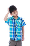 Attractive 7 year old boy making thinking expression. Isolated o Stock Photography