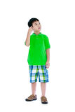 Attractive 7 year old boy making thinking expression. Isolated o Royalty Free Stock Images