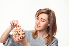 Attractive 24 year old business woman looking confused with wooden puzzle. Royalty Free Stock Photos