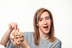 Attractive 24 year old business woman looking confused with wooden puzzle. Royalty Free Stock Photo