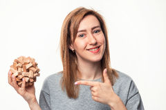 Attractive 24 year old business woman looking confused with wooden puzzle. Stock Photos