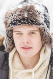 Attractive young adult man in winter clothes Royalty Free Stock Photos