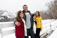 Attractive Young Adults Playing Together in Winter stock photography
