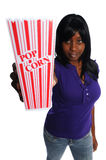 Attractive young african-american woman. Attractive african-american woman holding a container of popcorn on a white background Stock Photos