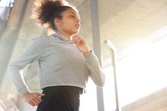 Attractive young african american woman running outdoors Stock Photo