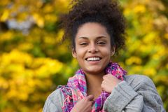 Attractive young african american woman smiling in autumn Royalty Free Stock Image
