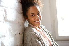 Attractive young african american woman smiling Stock Photo