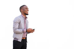 Attractive young african man with a mobile phone Royalty Free Stock Photos