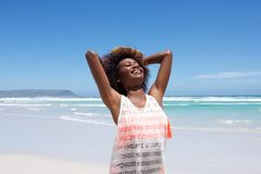 Attractive  young african woman enjoying a day at the beach Stock Images