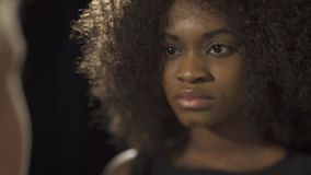 Attractive young african woman staring at her lover in pain or sad. stock footage