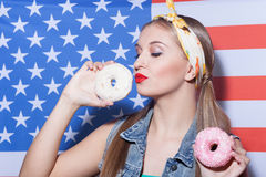 Attractive young American woman with sweet food Royalty Free Stock Images
